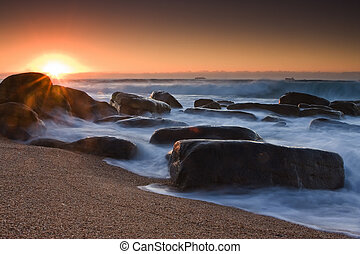 Sunrise flair - Rocky shore and sandy beach of Umhlanga near...