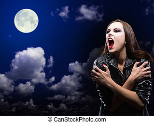 Zombie girl on night sky with moon