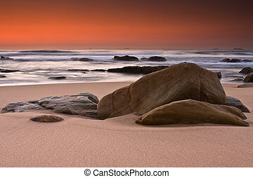 Sinrise rocks - Rocky shore and sandy beach of Umhlanga near...