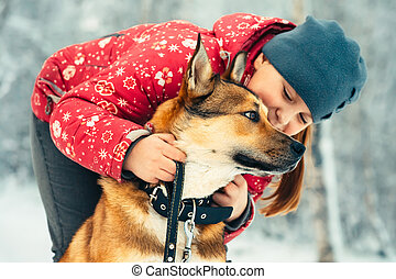 Girl Child and Dog hugging and playing Outdoor Lifestyle...