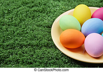 Easter tradition - Close-up of coloured Easter eggs on plate...