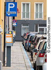 cars parked on the roadside, symbol for parking, fee,...
