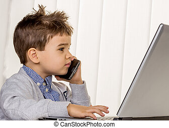 little boy on a laptop, symbol of the internet, e-commerce,...