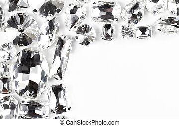 Large crystal strasses on a white background - macro photo -...
