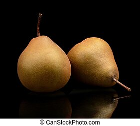 Two pair pears called manon isolated on black - Close-up...