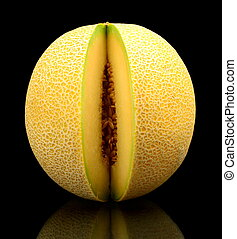 Melon galia notched isolated black in studio - Studio shot...