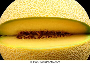 Close-up shot of melon galia notched isolated black -...