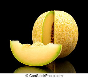Melon galia notched with slice isolated black in studio -...