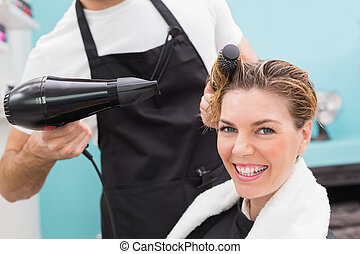 Woman getting her hair dried at the hair salon
