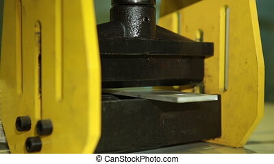 Hydraulic press closeup - Hydraulic machines flexes metal...