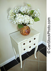 Hydrangeas - Bouquet of hydrangeas on a wooden dresser