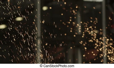 Flying sparks slow motion - Fiery sparks fly in slow motion