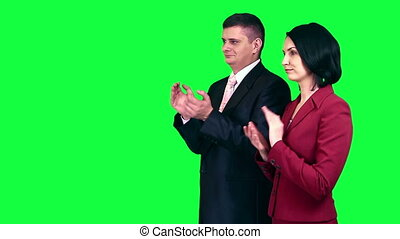Business people applauding - Business man and woman...