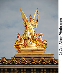 Muse. - Golden sculptural group of a female angel holding a...