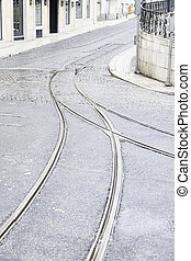 Tram tracks on a street in Lisbon, detail of a route for...