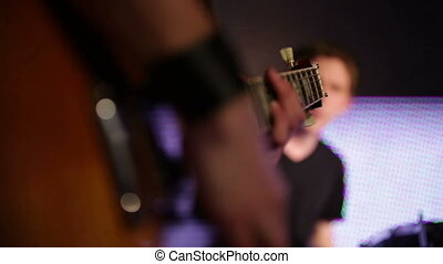 Rock musicians closeup - Guitar player, bass guitarist and...
