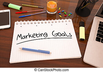 Marketing Goals - handwritten text in a notebook on a desk -...