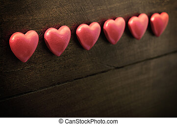 Three red heart on wooden background for valentine's day or...