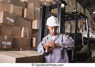 Warehouse worker checking time