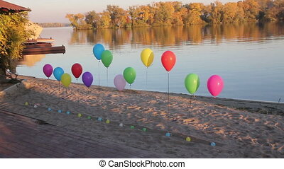 colored balloons near the river