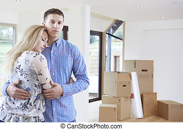 Young Couple Forced To Move Home Through Financial Problems