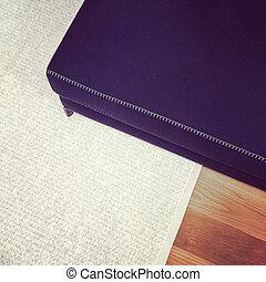 Blue bench on gray carpet. Modern furniture.