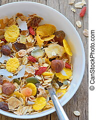 muslin cereal in a bowl on old wooden background