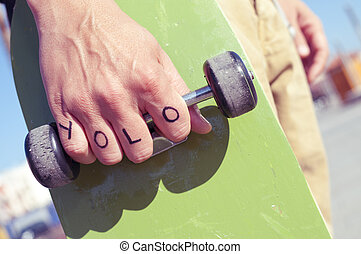 young man with the word yolo - closeup of a young man with...