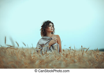 Girl in field covered with a cloth. - Girl stands in a field...