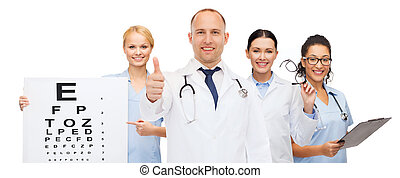 group of smiling doctors with eye chart