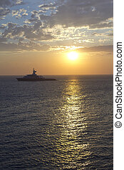 Large luxury yacht at sunset - Large private luxury yacht at...