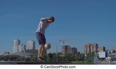 Neck Stall - Low angle of soccer freestyler joggling...