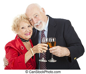 Seniors Toast with Champagne - Beautiful senior couple...