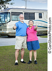 RV Seniors Thumbs Up - Senior couple in front of their...