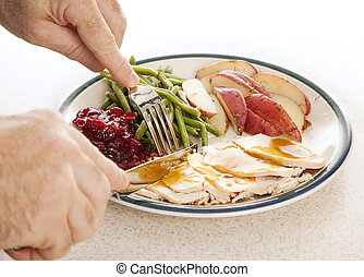 Turkey Dinner - Man\'s hands eating a delicious turkey...