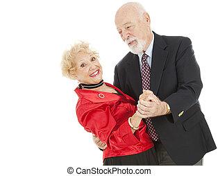 Dancing Seniors Dip - Senior man dips his beautiful wife as...