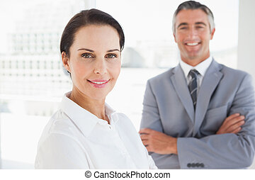 Smiling business woman at work with co worker