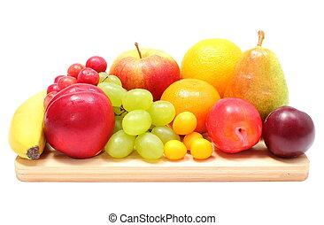 Fresh ripe fruits on wooden cutting board - Fresh ripe...
