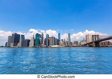 Brooklyn Bridge and Manhattan skyline New York city sunshine...