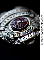 Fire Department Badge - A badge from a fire fighter on a...