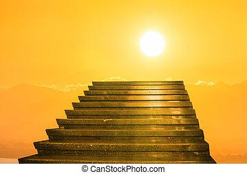 Stairway to heaven. Stairs towards sun on the orange sunset...