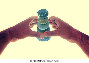 Pile of pebble Stones - Human hand protecting Five stones...