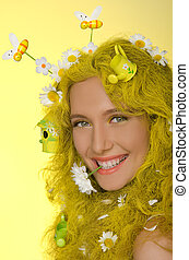 woman with yellow hair, flowers, and bees in them - Young...