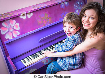 music - Mother with young son to play the piano