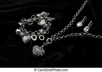 Costume Juwelery - Silver designer costume jewelery on black...