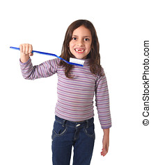 sweet cute young girl gap toothed with huge toothbrush...