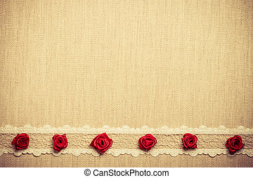 Frame of red silk roses on cloth - Valentines day, wedding,...