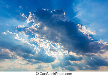 Dramatic cloudy sky clouds with real sun beams