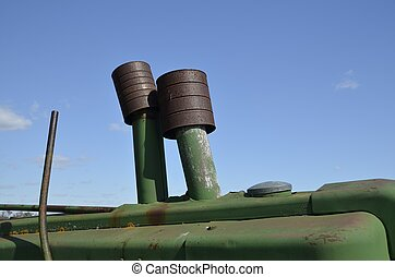 Tins cans cover tractor exhaust - Several rusty tin cans...