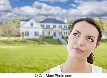Thoughtful Mixed Race Woman In Front of House - Thoughtful...